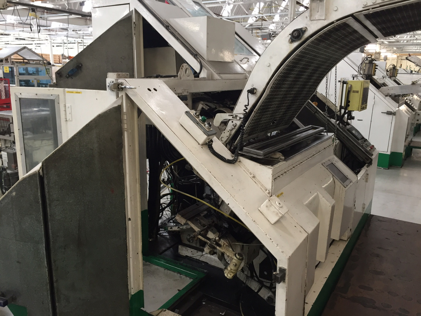automatic transport from scroll shear to stripfeed press